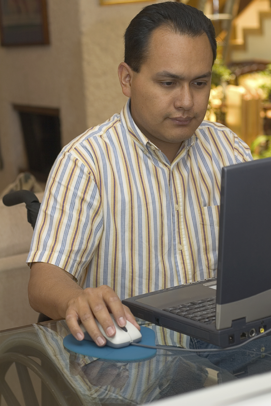 NWS Minority in a wheelchair at computer